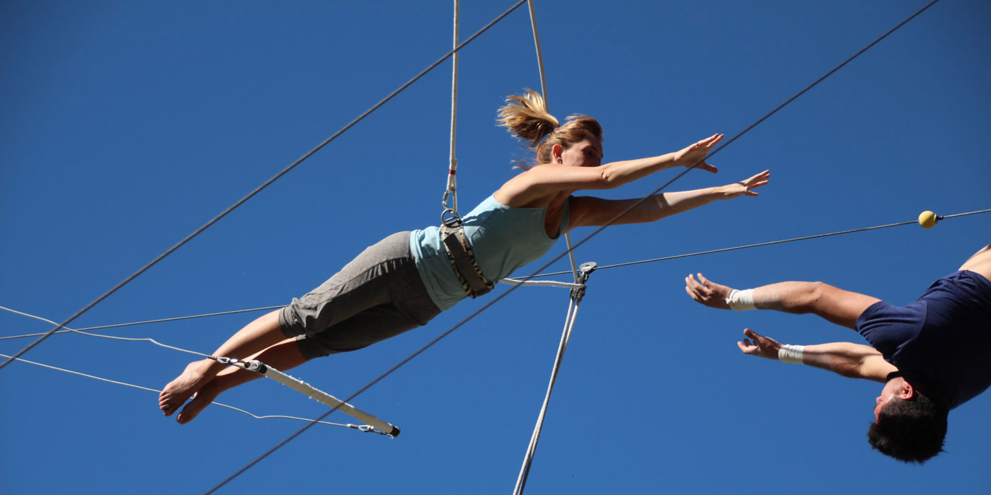 Woman flying on trapeze