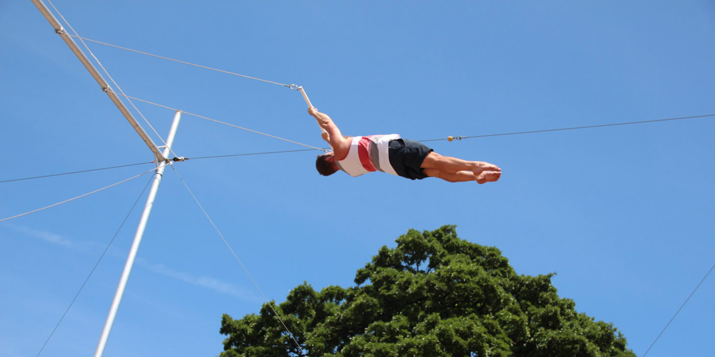 Man flying on trapeze